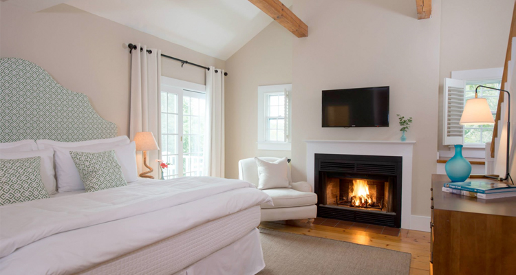 Romantic hotel room with white walls, and a fireplace