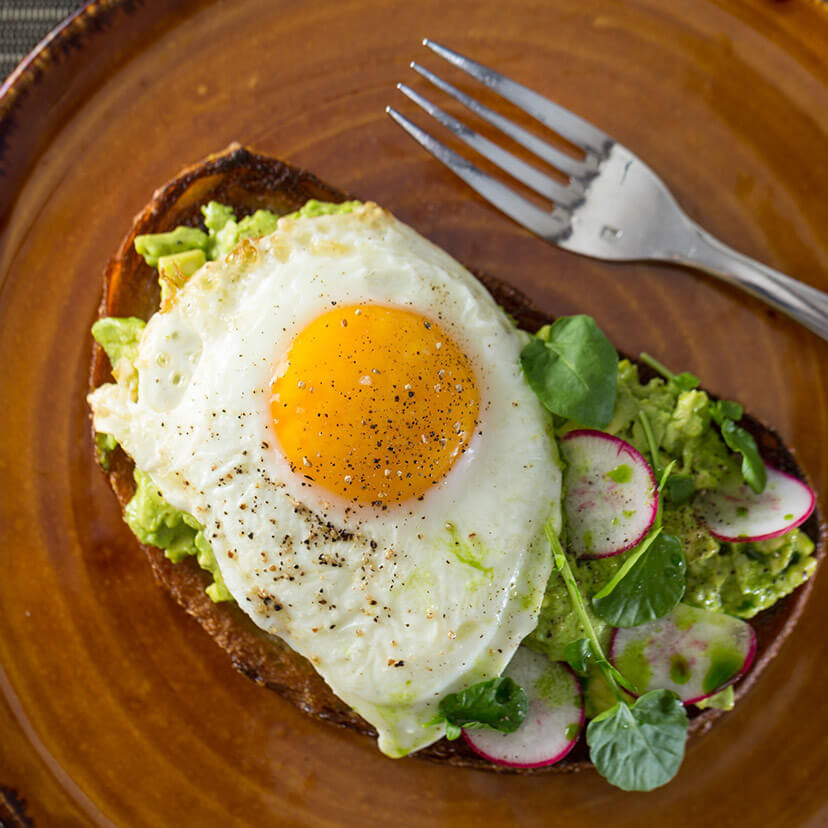 Breakfast - avocado toast with an egg
