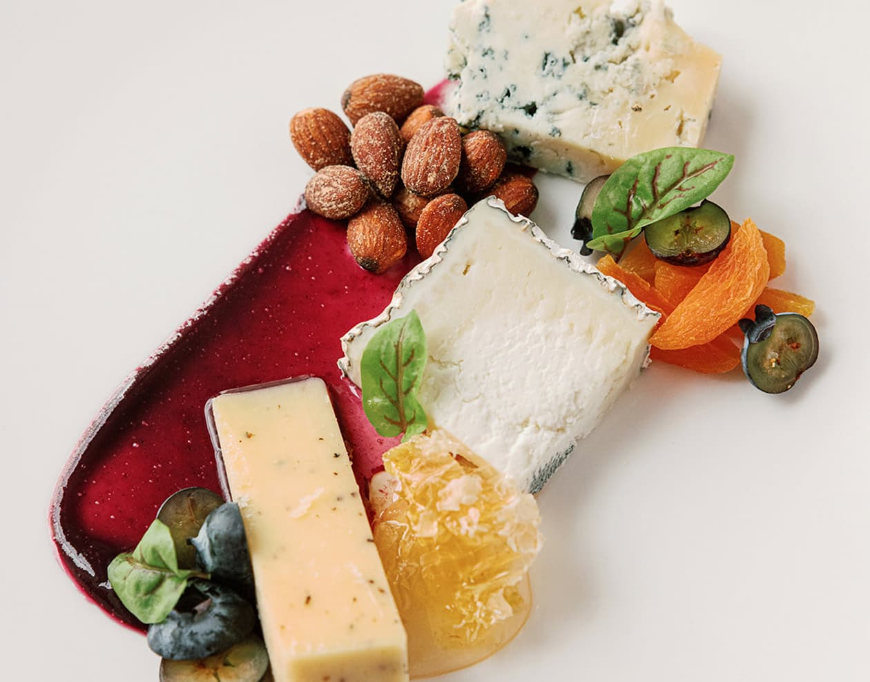 plate of cheeses and fruits