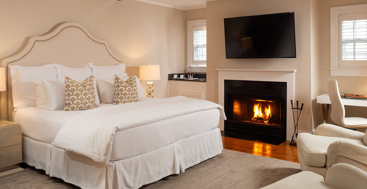 Room 2 bed and fireplace