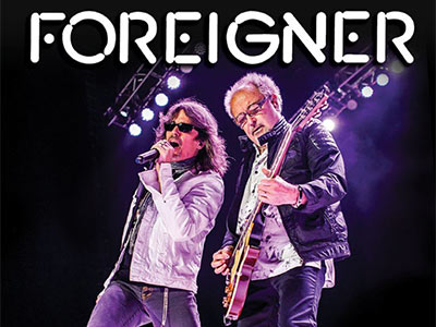 Foreigner - Band singing with guitar