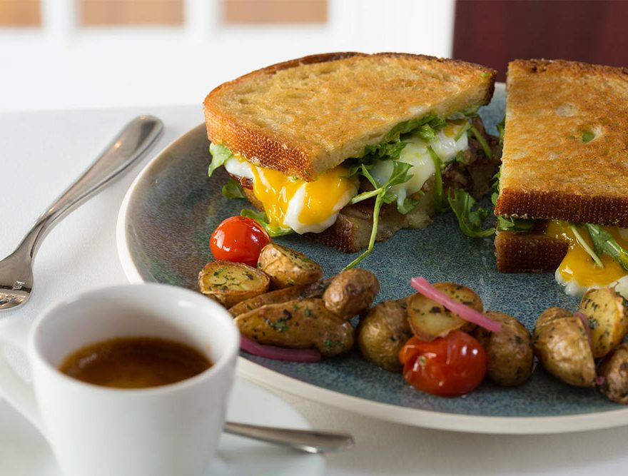 Breakfast Sandwich with potatoes and coffee - Breakfast at a Chatham Hotel