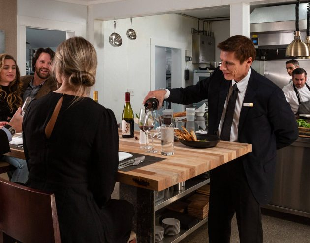 Serving wine at the Chef's Table