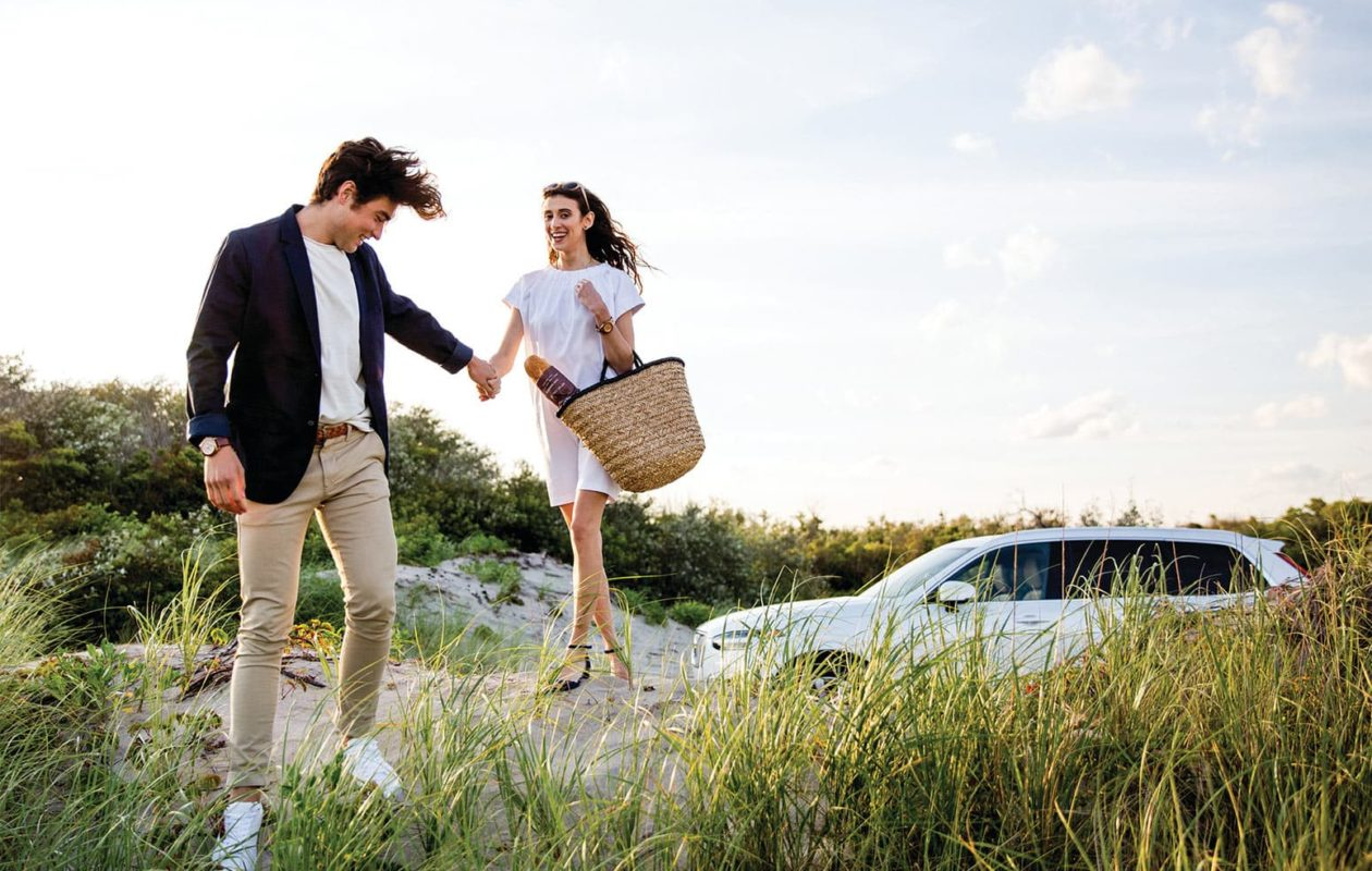 Young Couple sightseeing in MA in a Volvo SUV
